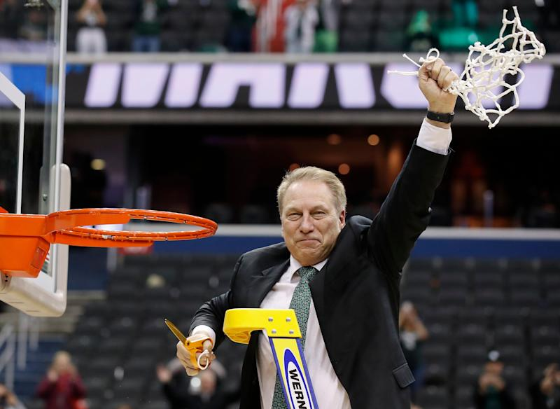 Michigan State head coach Tom Izzo holds up the net after defeating Duke in an NCAA men's East Regional final college basketball game in Washington Sunday