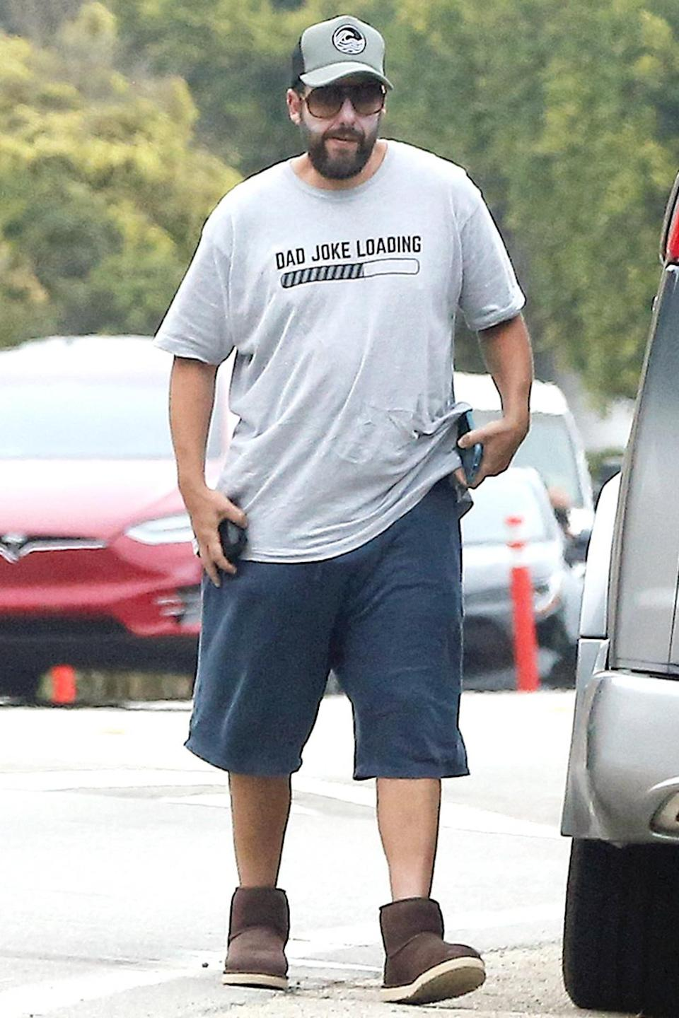 <p>Adam Sandler keeps up with social distancing practices, heading to the back of his car to retrieve food that's been delivered in Malibu on Saturday.</p>
