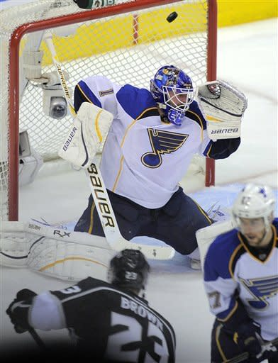 Los Angeles Kings right wing Dustin Brown (23) scores on St. Louis Blues goalie Brian Elliott during the first period in Game 4 of an NHL hockey Stanley Cup second-round playoff series, Sunday, May 6, 2012, in Los Angeles. (AP Photo/Mark J. Terrill)