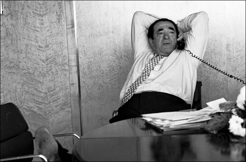 Robert Maxwell reclining at his desk while on the telephone, 1987. (Photo by Michael Ward/Getty Images)