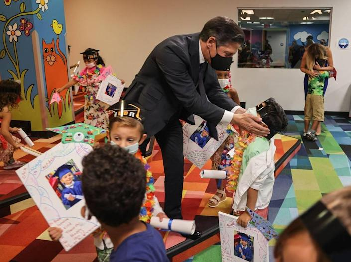 Superintendent Alberto Carvalho, center, bids iPrep Academy pre-K students a wonderful summer as Aillette Rodriguez-Diaz, assistant principal grades pre-K-5, hugs departing students at the end of the school year on Wednesday, June 9, 2021.
