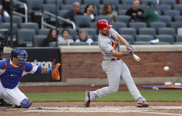 St. Louis Cardinals' Paul DeJong hits an RBI single during the 10th inning of the continuation of a rain-suspended baseball game against the New York Mets, Friday, June 14, 2019, in New York. New York Mets catcher Wilson Ramos is behind the plate. (AP Photo/Kathy Willens)