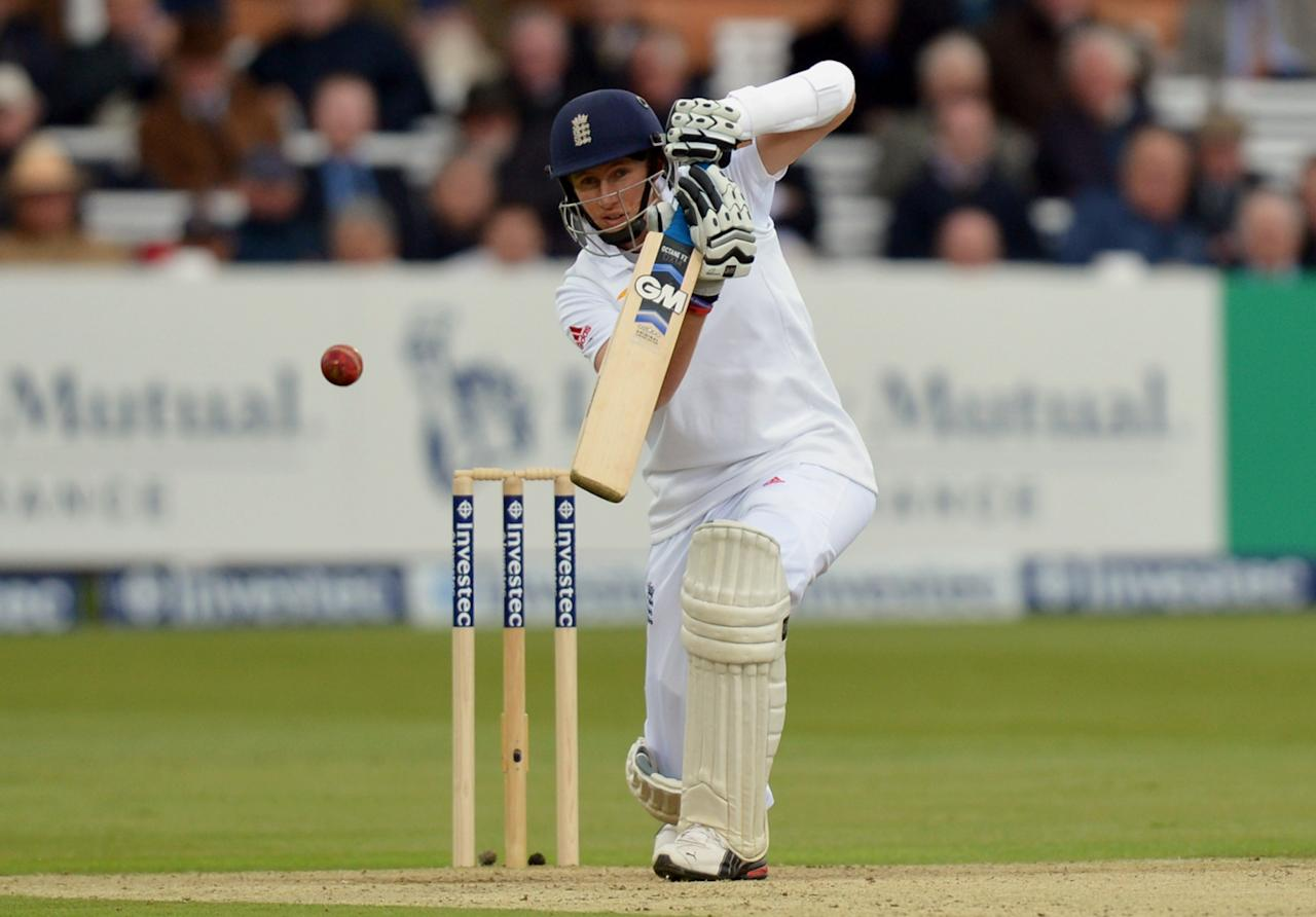 England's Joe Root bats during the first test at Lord's Cricket Ground, London.