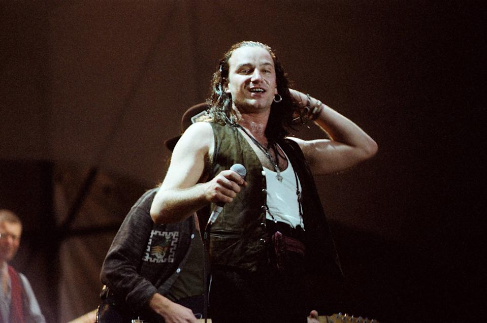 LONDON, UNITED KINGDOM - JUNE 12: Bono of U2 performs on stage at Wembley Stadium on June 12th, 1987 on 'The Joshua Tree' tour in London, England. (Photo by Pete Still/Redferns)