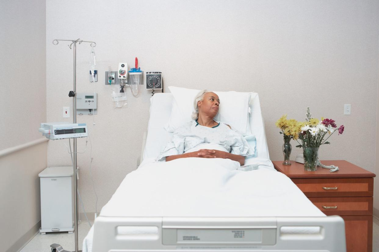 black woman laying in hospital bed