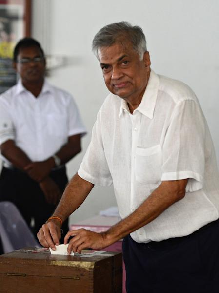 Prime Minister Ranil Wickremesinghe, pictured here in Colombo on January 8, 2015, said he was withdrawing plans to strip the president of some of his executive powers (AFP Photo/Munir Uz Zaman)
