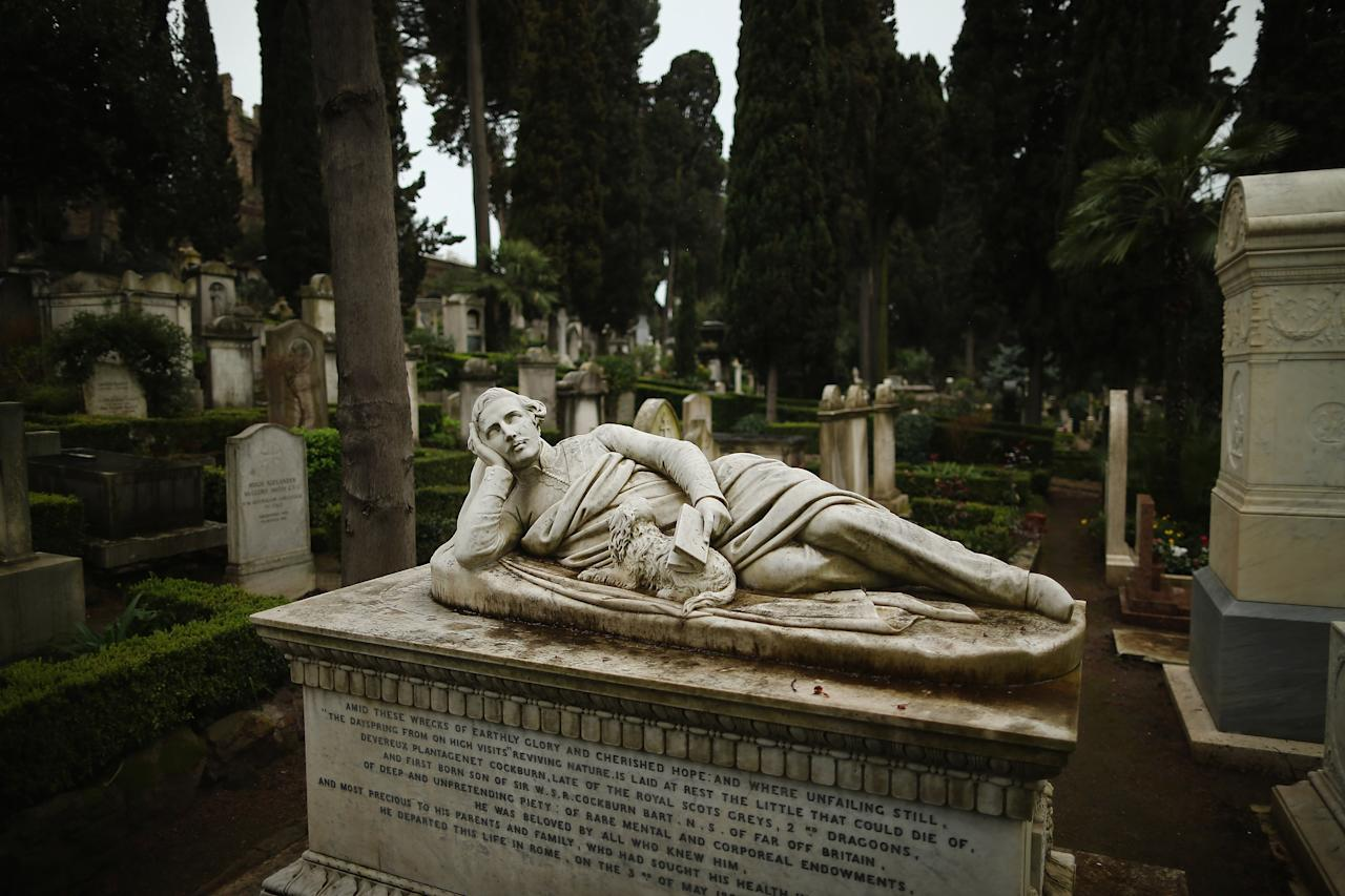 ROME, ITALY - MARCH 26:  The tomb of Devereux Plantagenet Cockburn rests in Rome's 'Non Catholic Cemetery' on March 26, 2013 in Rome, Italy. Rome's Non-Catholic Cemetery contains one of the highest densities of famous and important graves anywhere in the world including John Keats, one of England's most famous poets, who died early in 1820 of tuberculosis aged 25, after travelling to Italy in search of a better climate to help cure him of the disease. As well as being the final resting-place of the poets Percy Shelley and John Keats, it is also home to graves of many other painters, sculptors and authors who died in Rome. The cemetery which began it's use in 1730 continues today, containing graves of Orthodox Christians, Jews, Muslims and other non-Christians, and is one of the oldest burial grounds in Europe.  (Photo by Dan Kitwood/Getty Images)