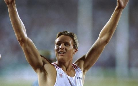 <span>Roger Black celebrating his silver medal for the men's 4x400m relay at the Olympic Stadium in Atlanta in 1996</span> <span>Credit: Pascal Rondeau/Getty </span>