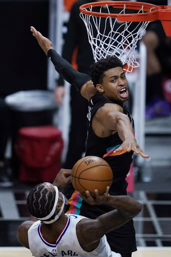 San Antonio Spurs guard Keldon Johnson (3) defends against Los Angeles Clippers forward Kawhi Leonard, front, during the second quarter of an NBA basketball game Tuesday, Jan. 5, 2021, in Los Angeles. (AP Photo/Ashley Landis)