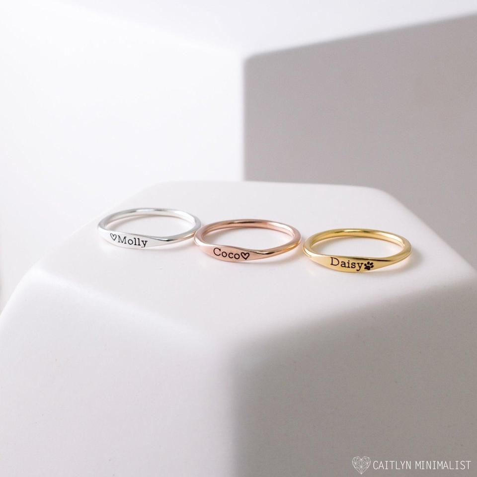 <p>Stack these <span>Caitlyn Minimalist Dainty Name Rings</span> ($20, originally $27 each) together for an attractive eye candy.</p>