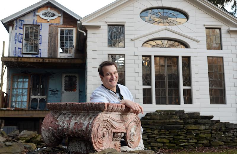 """In this photo taken Feb. 1, 2012, Bronson Pinchot poses for photos near the rear facade of the Decker House, one of six properties he owns in Harford, Pa. Pinchot, best known for his starring role on the 1980's sitcom """"Perfect Strangers,"""" is back on TV with a new show about restoring his historic Pennsylvania homes. The show, """"The Bronson Pinchot Project,"""" premiered this month on the DIY cable network. (AP Photo/Heather Ainsworth)"""