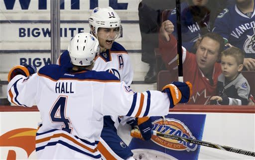 Edmonton Oilers' Taylor Hall, left, and Jordan Eberle celebrate Eberle's goal against the Vancouver Canucks during the second period of an NHL hockey game in Vancouver, British Columbia, on Sunday, Jan. 20, 2013. (AP Photo/The Canadian Press, Darryl Dyck)
