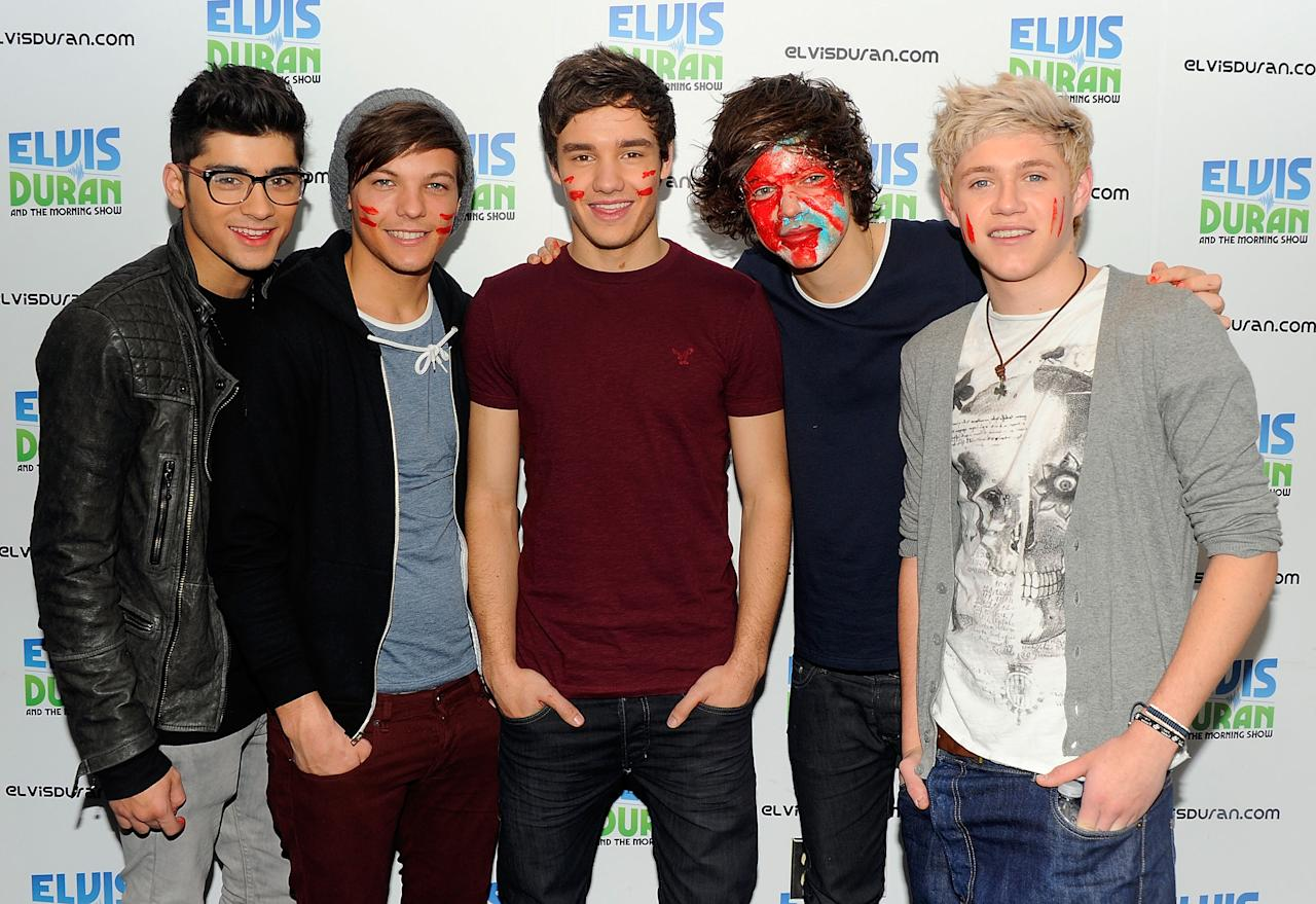 """NEW YORK, NY - MARCH 14:  One Direction band members (L-R) Zayn Malik, Louis Tomlinson, Liam Payne, Harry Styles and Niall Horan visit """"The Elvis Duran Z100 Morning Show"""" at Z100 Studio on March 14, 2012 in New York City. The interview was recorded and aired on March 16, 2012.  (Photo by Andrew H. Walker/Getty Images)"""