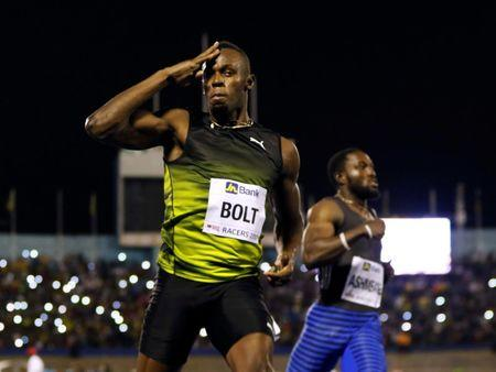 FILE PHOTO: Jamaica's Olympic champion Usain Bolt (L) gestures after winning his final 100 meters sprint at the 2nd Racers Grand Prix at the National Stadium in Kingston, Jamaica June 10, 2017. REUTERS/Gilbert Bellamy