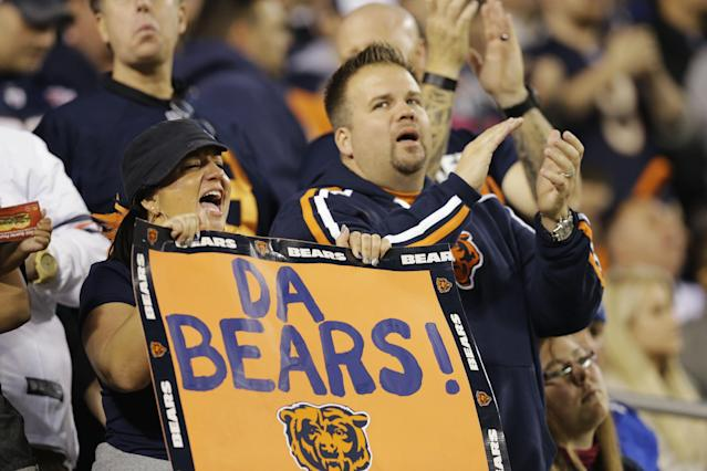 Chicago Bears fans cheer in the first half of the Bears' NFL football game against the New York Giants, Thursday, Oct. 10, 2013, in Chicago. (AP Photo/Nam Y. Huh)