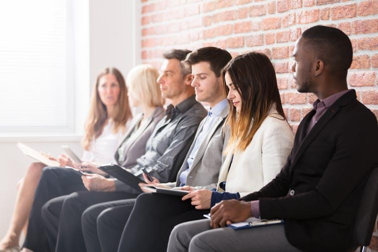 """<span class=""""caption"""">Economists warn if employers avoid hiring underrepresented groups in their sector, this can lead to a vicious circle of continued exclusion.</span> <span class=""""attribution""""><a class=""""link rapid-noclick-resp"""" href=""""https://www.shutterstock.com/image-photo/group-diverse-people-waiting-job-interview-657215752"""" rel=""""nofollow noopener"""" target=""""_blank"""" data-ylk=""""slk:Andrey Popov/Shutterstock"""">Andrey Popov/Shutterstock</a></span>"""