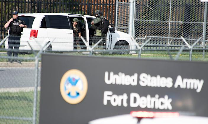 Members of the Frederick Police Department Special Response Team prepare to enter Fort Detrick following a shooting in the Riverside Tech Park on Tuesday.