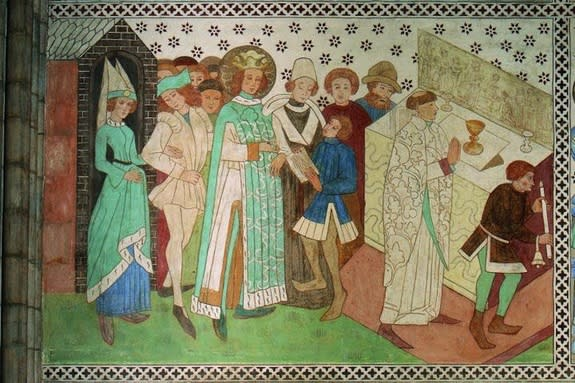 A mural painting, displayed in Uppsala Cathedral, of King Erik during mass.