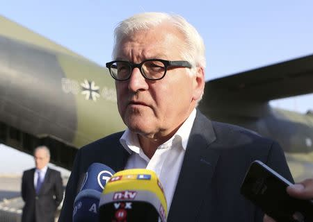 Germany's Foreign Minister Frank-Walter Steinmeier speaks to the media upon his arrival to Baghdad International Airport