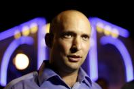FILE PHOTO: File photo of then head of the Beit Yehudi party Bennett campaigning at a bar in Ashdod