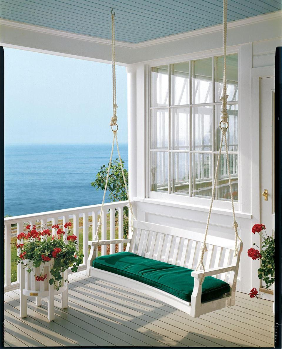 <p>Take in the pretty view with an outdoor swing, complete with a comfy cushion that's meant for lounging. </p>
