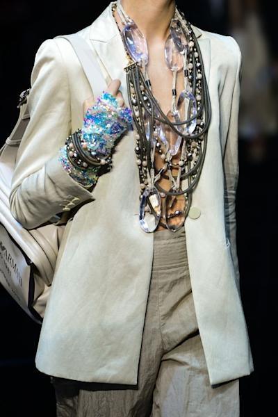 Layers of necklaces and bracelets at Emporio Armani. Milan, September 20, 2018