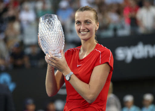 Petra Kvitova of the Czech Republic holds the winners trophy after beating Ashleigh Barty of Australia after their women's final match at the Sydney International tennis tournament in Sydney, Australia, Saturday, Jan. 12, 2019. (AP Photo/David Moir)