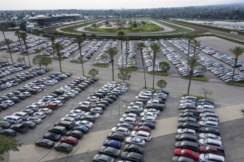 SANTA ANITA, CA, WEDNESDAY, APRIL 29, 2020,Thousands of cars are stored a the Santa Anita racetrack parking lot. (Robert Gauthier / Los Angeles Times)