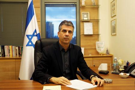 Israel's Economy Minister Eli Cohen poses for a picture at his office in the Knesset, the Israeli parliament, in Jerusalem