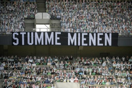 "A banner reading ""Silent Faces"", surrounded by cardboard cut-out of Borussia Moenchengladbach fans, during Saturday's 3-1 home defeat to Leverkusen"