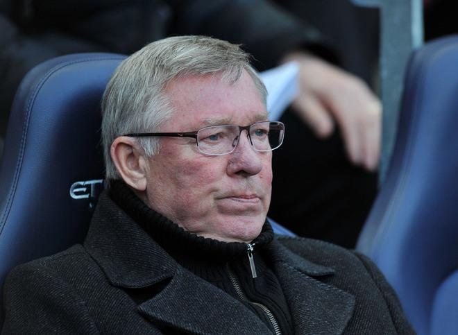 """Manchester United manager Alex Ferguson gestures as he watches his team play against Manchester City during their English Premier League match at The Etihad Stadium in Manchester, north-west England, on April 30, 2012. AFP PHOTO/PAUL ELLIS  - RESTRICTED TO EDITORIAL USE. No use with unauthorized audio, video, data, fixture lists, club/league logos or """"live"""" services. Online in-match use limited to 45 images, no video emulation. No use in betting, games or single club/league/player publicationsPAUL ELLIS/AFP/GettyImages"""