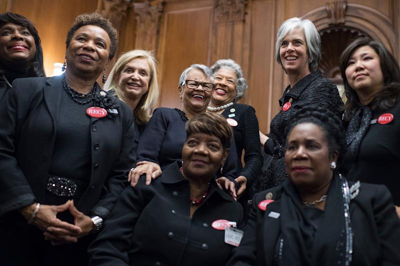 Members of Congress pose with Rose Gunter, the niece of sexual assault survivor Recy Taylor, to show solidarity with men and women who are speaking out against sexual harassment and discrimination.