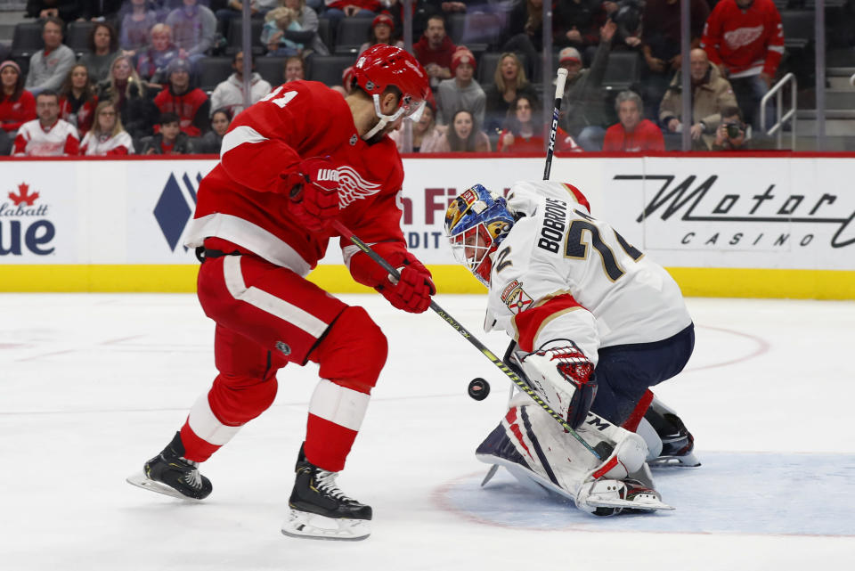 Florida Panthers goaltender Sergei Bobrovsky (72) stops a shot by Detroit Red Wings center Frans Nielsen (81) during the third period of an NHL hockey game Saturday, Jan. 18, 2020, in Detroit. (AP Photo/Paul Sancya)