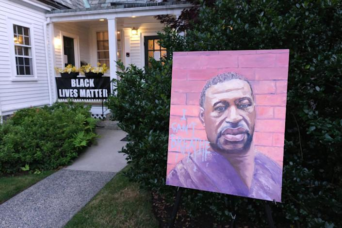 A portrait of George Floyd is on display outside the Unitarian Universalist Church where the North Shore Solidarity March: We Still Can't Breathe concluded in Marblehead, Mass., on July 31, 2020.