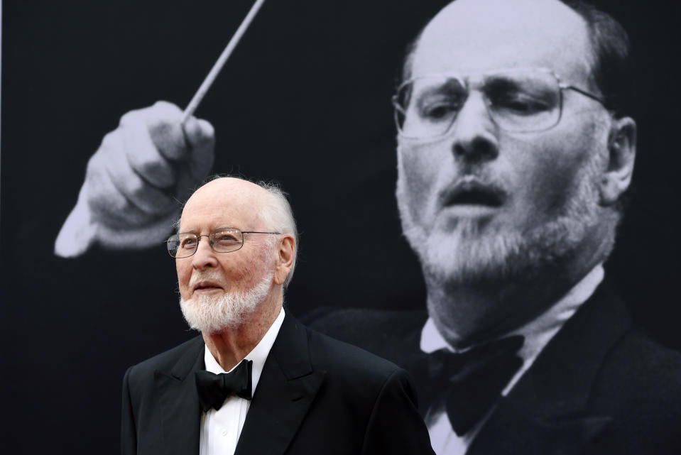 """FILE - In this June 9, 2016, file photo, composer John Williams poses on the red carpet at the 2016 AFI Life Achievement Award Gala Tribute to John Williams at the Dolby Theatre in Los Angeles. The composer of the music scores for """"Star Wars,"""" """"Indiana Jones"""" and other iconic films is being honored by his former orchestra. The Boston Pops Orchestra is kicking off a series of performances devoted to the music of John Williams with concerts on April 7 and 8, 2017. Williams served as the ensemble's conductor from 1980 to 1993 and is its conductor laureate. (Photo by Chris Pizzello/Invision/AP, File)"""