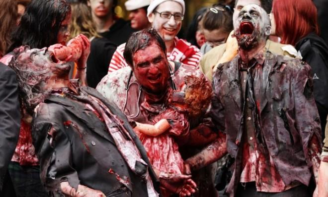 Men dressed as zombies walk through the central business district during the Sydney Zombie Walk on Oct. 24.