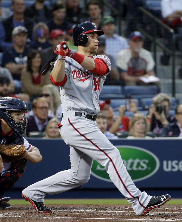 Washington Nationals' Bryce Harper singles in the second inning of a baseball game against the Atlanta Braves, Friday, April 11, 2014, in Atlanta. (AP Photo/David Goldman)