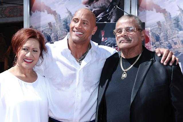 WWE star Rocky Johnson, right, died on Wednesday. He was 75. (Richard Shotwell/Invision/AP)