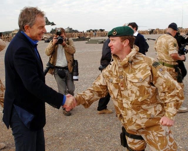 Tony Blair pictured making a surprise visit to Afghanistan when prime minister