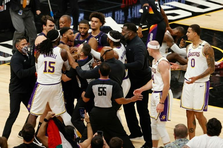 Los Angeles Lakers and Phoenix Suns players and staff scuffle in an incident which led to the ejection of Phoenix's Cameron Payne