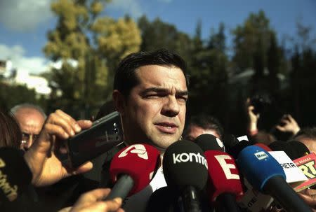 Alexis Tsipras, opposition leader and head of radical leftist Syriza party, talks to reporters outside the parliament building after the last round of a presidential vote in Athens December 29, 2014. REUTERS/Alkis konstantinidis