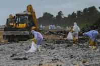 Bulldozers scooped up tonnes of polythene pellets that came from containers that fell off the ship