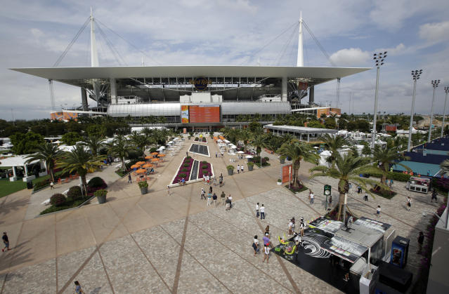 The grounds and outside courts for the Miami Open tennis tournament are viewed outside of Hard Rock Stadium, Monday, March 18, 2019, in Miami Gardens, Fla. The Miami Open has moved north from its home since 1987, the picturesque island of Key Biscayne, and will begin Tuesday at the home of the Miami Dolphins and the Miami Hurricanes. (AP Photo/Lynne Sladky)
