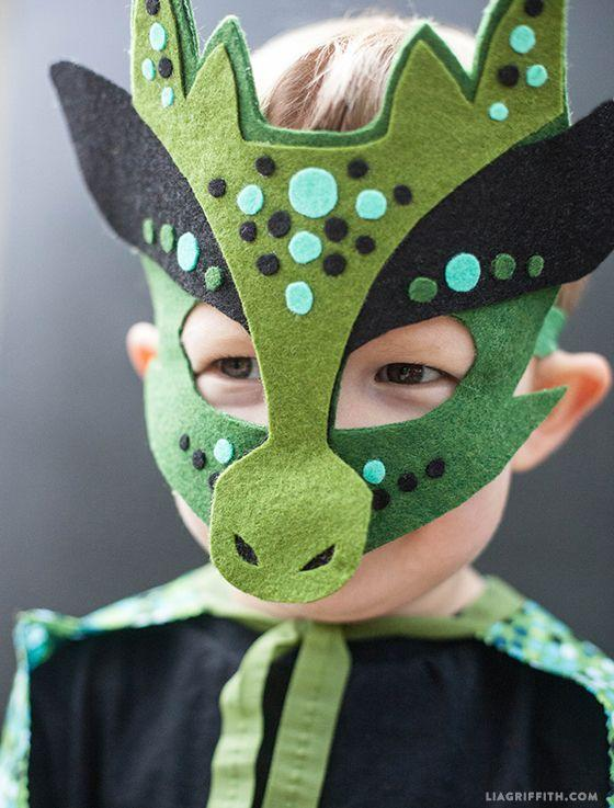 """<p>Every fierce dragon needs a great mask in order to truly look the part. This no-sew wonder will do the trick.</p><p><strong>Get the tutorial at <a href=""""https://go.redirectingat.com?id=74968X1596630&url=http%3A%2F%2Fliagriffith.com%2Fhomemade-halloween-costumes-no-sew-dragon-mask-and-cape%2F&sref=https%3A%2F%2Fwww.countryliving.com%2Fdiy-crafts%2Fg3480%2Fdiy-halloween-masks%2F"""" rel=""""nofollow noopener"""" target=""""_blank"""" data-ylk=""""slk:Lia Griffith"""" class=""""link rapid-noclick-resp"""">Lia Griffith</a></strong>. </p><p><a class=""""link rapid-noclick-resp"""" href=""""https://www.amazon.com/flic-flac-42pcs1-4mm-Assorted-Nonwoven-Patchwork/dp/B06WVFBM8D/?tag=syn-yahoo-20&ascsubtag=%5Bartid%7C10050.g.3480%5Bsrc%7Cyahoo-us"""" rel=""""nofollow noopener"""" target=""""_blank"""" data-ylk=""""slk:SHOP FELT FABRIC SHEETS"""">SHOP FELT FABRIC SHEETS</a> </p>"""
