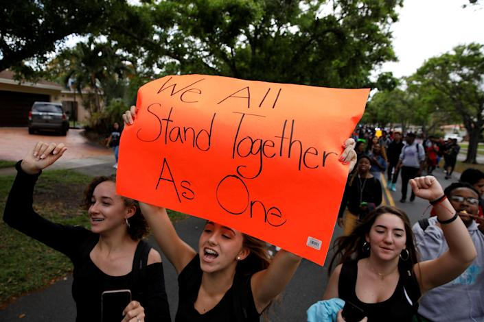 <p>Students from South Plantation High School carrying placards and shouting slogans walk on the street during a protest in support of the gun control, following a mass shooting at Marjory Stoneman Douglas High School, in Plantation, Fla., Feb. 21, 2018. (Photo: Carlos Garcia Rawlins/Reuters) </p>