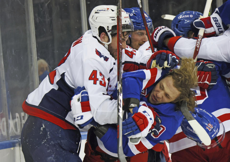 Washington Capitals' Tom Wilson (43) takes a roughing penalty during the second period against New York Rangers' Artemi Panarin (10) in an NHL hockey game Monday, May 3, 2021, in New York. (Bruce Bennett/Pool Photo via AP)