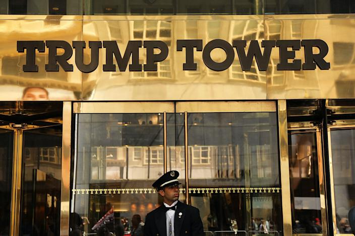 A guard stands outside of Trump Tower on Fifth Avenue in Manhattan on August 24, 2018.
