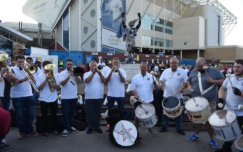 "The love-it-or-loathe-it England Band has been cleared to play at the World Cup - despite a ban on musical instruments at the tournament. Telegraph Sport can reveal the band has been granted an exemption from rules prohibiting instruments other than ""horns and pipes"" being brought into stadiums during Russia 2018. The band was banned from the last World Cup in Brazil and only a last-minute intervention spared it the same fate at the 2016 European Championship. This time, it has left nothing to chance, according to band leader John Hemmingham. ""We've got an official letter that says we can get in,"" he told Telegraph Sport, revealing the Football Association had successfully lobbied tournament organisers on the band's behalf. ""It means the world to us, obviously, because we can go in and do what we do now. We can, to a certain extent, determine the mood."" The England Band plays for supporters ahead of the match between England and Costa Rica at Elland Road, Leeds Credit: AFP Hemmingham revealed four members of the band were travelling to Russia and would bring with them two sets of drums, a trumpet and a euphonium (small tuba). They were due to arrive in Volgograd on Sunday morning ahead of England's opening match against Tunisia. Hemmingham said the band had yet to decide whether to strike up in the streets before or after Monday's game, adding: ""We'll just weigh it up and see what the situation is."" Admitting band members had ""concerns"" about how they would be greeted due to the diplomatic crisis between Britain and Russia and the latter's hooligan problem, he said: ""We won't be doing anything to cause any unwanted attention."" WorldCup - newsletter promo - end of article The band began playing at England matches in 1996 and had followed the team around the world before being banned by from the last World Cup. It was also refused entry to the team's opening match of Euro 2012 before being allowed into the rest of the games. And it was almost denied access to England's Euro 2016 matches after the FA failed to apply for an exemption to tournament rules on instruments. The list of prohibited items at World Cup games this summer includes: ""musical instruments and wind instruments for producing loud sounds (including vuvuzelas). The only exceptions are horns and pipes"". World Cup whatsapp promo"