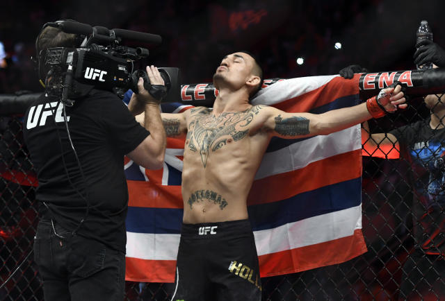 Featherweight champ Max Holloway fully intends on defending both belts if he beats Khabib Nurmagomedov on Saturday at UFC 223 for the lightweight title. (AP)
