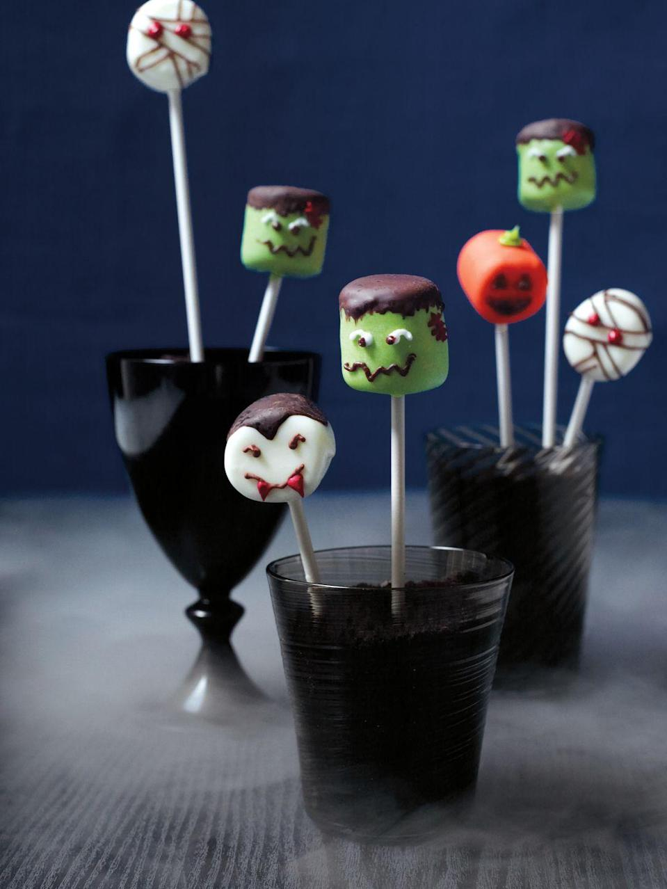"""<p>Allow your dessert to serve as a Halloween centerpiece. Graphic marshmallow monster pops, for instance, fit the bill. </p><p><a class=""""link rapid-noclick-resp"""" href=""""https://www.amazon.com/Puffed-Marshmallows-16-Ounce-Bags-Pack/dp/B002UL1K38/?tag=syn-yahoo-20&ascsubtag=%5Bartid%7C10055.g.33437890%5Bsrc%7Cyahoo-us"""" rel=""""nofollow noopener"""" target=""""_blank"""" data-ylk=""""slk:SHOP MARSHMALLOWS"""">SHOP MARSHMALLOWS</a></p>"""
